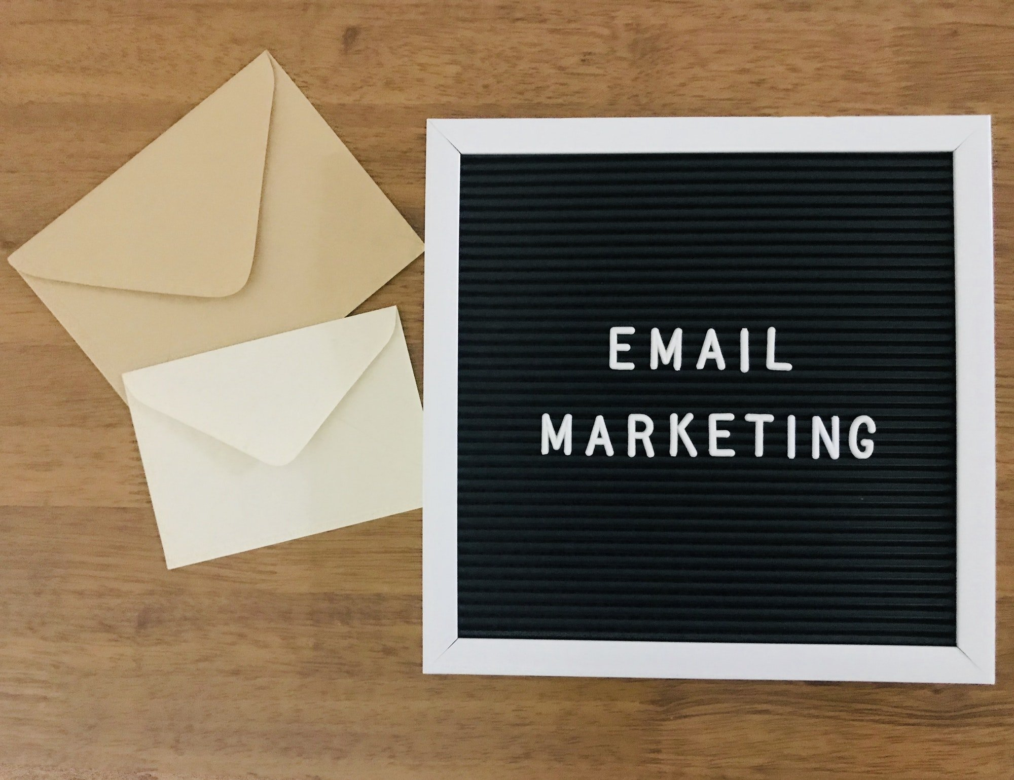 email marketing theme on wooden background